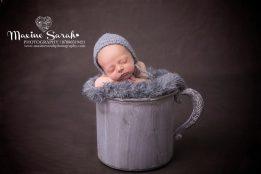 baby props newborn in hands