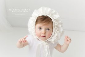 baby in a bonnet baby photographer